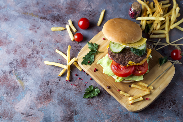 Hamburger with french fries, beer on a stone table - Stock Photo - Images