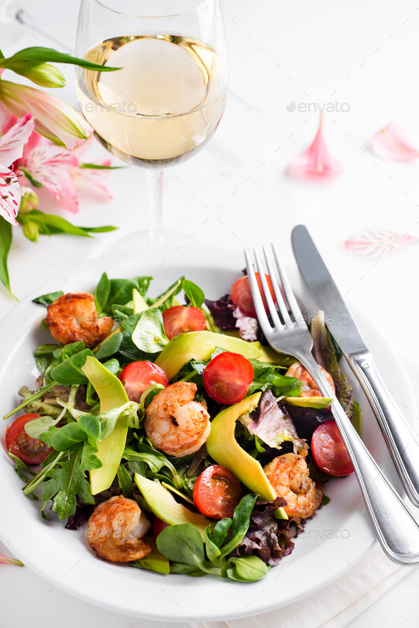 Avocado shrimp salad with cherry tomatoes - Stock Photo - Images