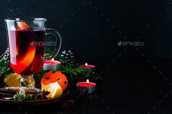 Mulled wine and spices on wooden background. - Stock Photo - Images