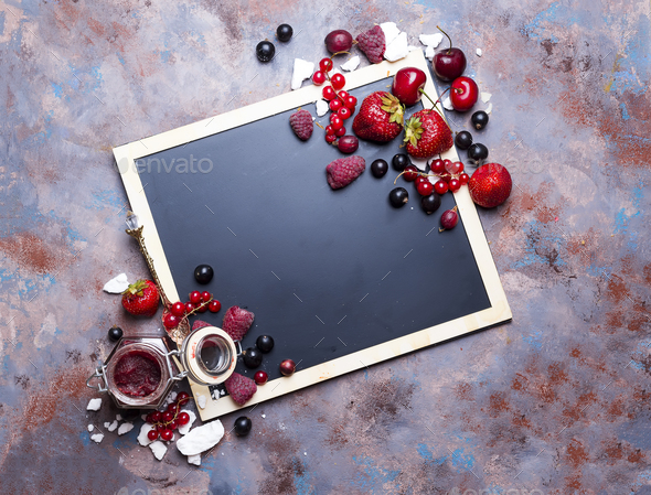 Berries jam in glass jar on table - Stock Photo - Images