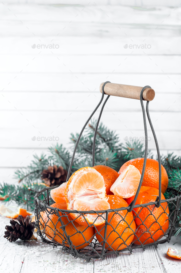 Tangerines with leaves on wooden table. - Stock Photo - Images