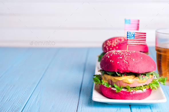 two tasty hamburgers with little American flags - Stock Photo - Images