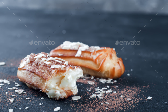 Tasty eclairs on table - Stock Photo - Images