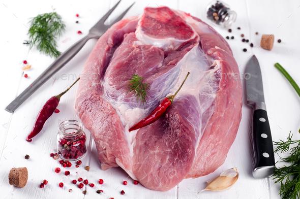 piece of fresh pork on the bone - Stock Photo - Images