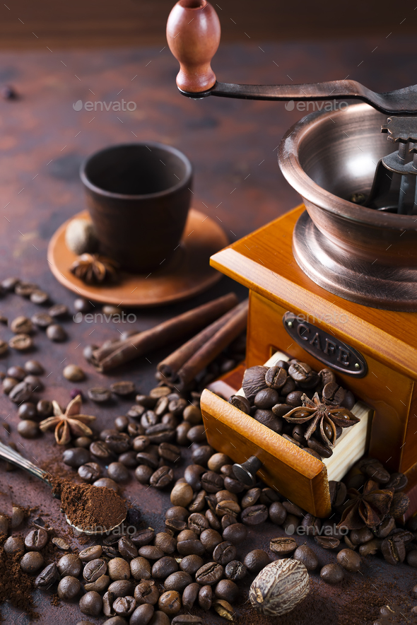 still life of coffee beans with coffee grinder - Stock Photo - Images