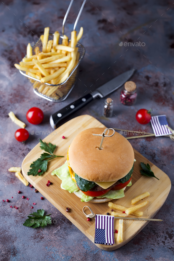 Fresh and juicy hamburger on a paper - Stock Photo - Images