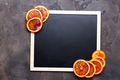 orange rings on a black chalkboard.