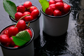 Cherry in enamel cup on black background. Healthy, summer fruit. Cherries.