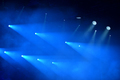 Background of blue stage lights. Space for text