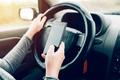 Woman using car navigation on smartphone