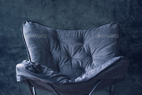 Empty foldable chair against gray wall - Stock Photo - Images
