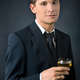 Portrait of a beautiful man with a glass of champagne - PhotoDune Item for Sale