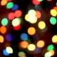 Christmas Bokeh Light Abstract Holiday Background. Defocused Ligths of Christmas Tree - VideoHive Item for Sale