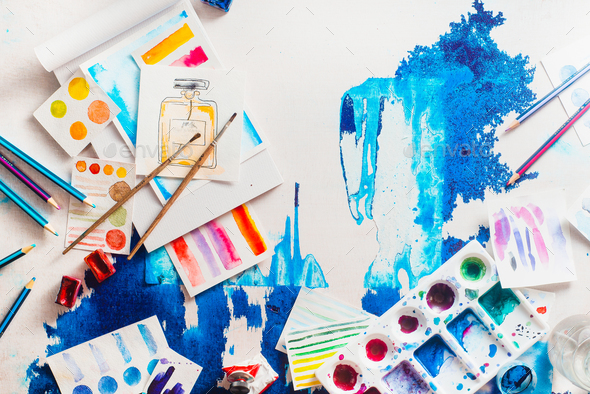 Flatlay artist workplace with watercolor and brushes - Stock Photo - Images