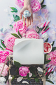 Writer's workplace with typewriter, stationary, crumpled paper and pink peony flowers - PhotoDune Item for Sale