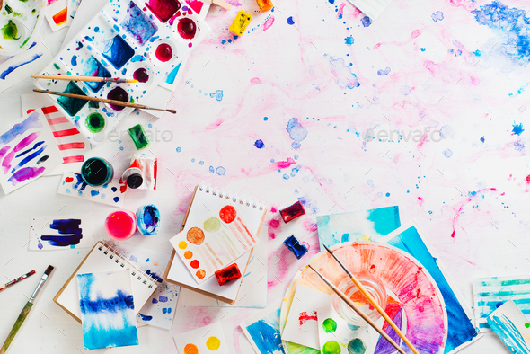 Feminine artist workplace with watercolor palettes and color circle - Stock Photo - Images