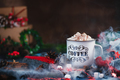 Hot chocolate with marshmallows in a cozy enamel mug with steam and Christmas decorations - PhotoDune Item for Sale