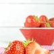 Fresh Strawberries on a Table and in a Bowl - PhotoDune Item for Sale