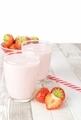 Strawberry Yogurt Milkshake on a Wooden Table. - PhotoDune Item for Sale
