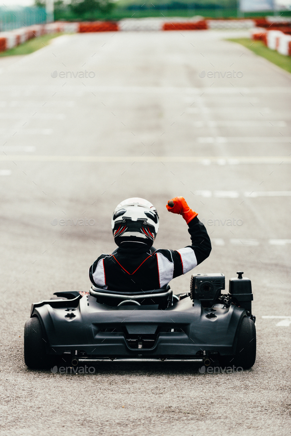 Woman driving go-cart