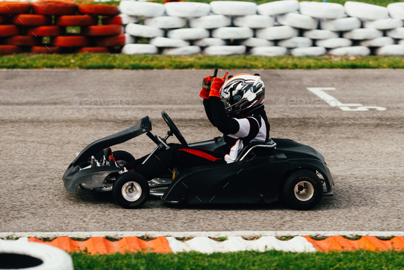 Woman driving go-cart - Stock Photo - Images