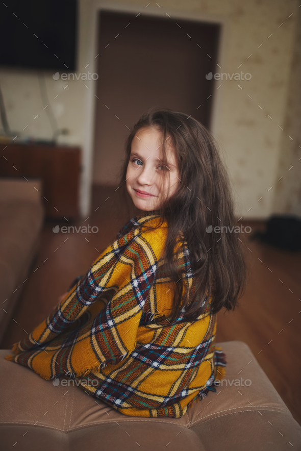 little girl with plaid at home - Stock Photo - Images