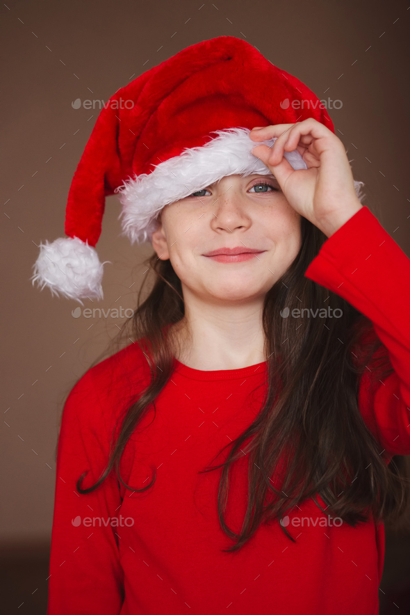 happy little girl with santa hat - Stock Photo - Images
