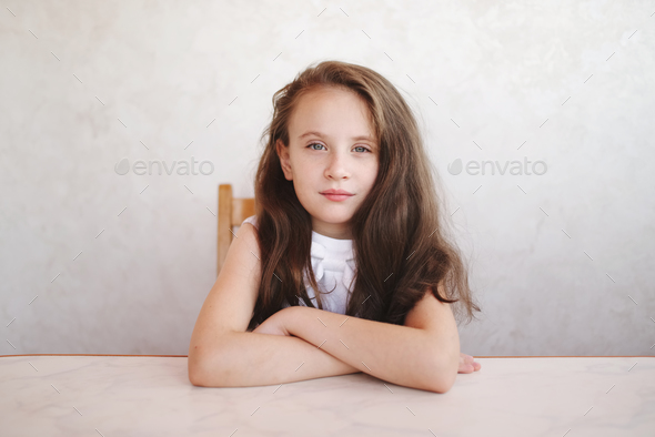 little girl sitting at the table - Stock Photo - Images