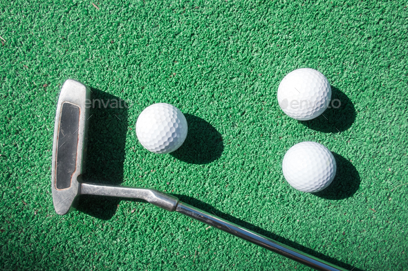 Mini golf scene with ball and club - Stock Photo - Images
