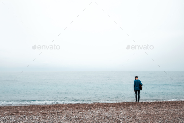 Alone boy stay near sea - Stock Photo - Images