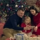 Parents and Daughter Make a Joint Photograph at the Christmas Tree - VideoHive Item for Sale