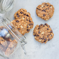 Flourless gluten free peanut butter, oatmeal and chocolate chips cookies in jar, top view