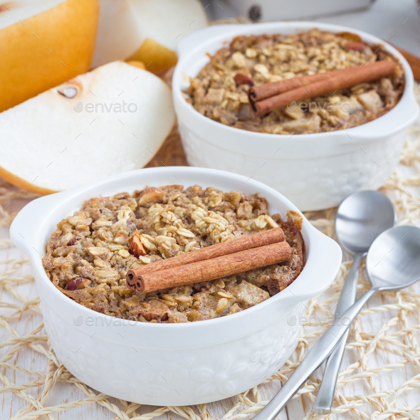 Baked oatmeal with nuts, almond milk, honey, spices and asian pear, square - Stock Photo - Images