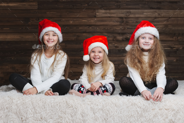 cute happy children with santa hats - Stock Photo - Images