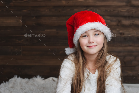 little happy girl with santa hat - Stock Photo - Images