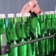 An Employee of the Production Line Wipes Green Glass Bottles for Mineral Water. - VideoHive Item for Sale