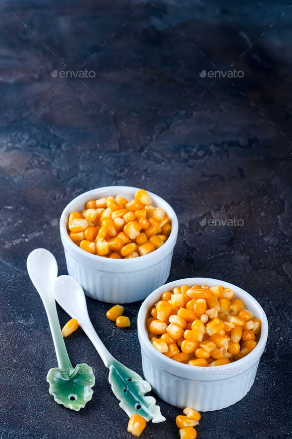 Boiled corn kernels in white cups - Stock Photo - Images