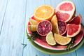 Sliced citrus fruit on the plate.