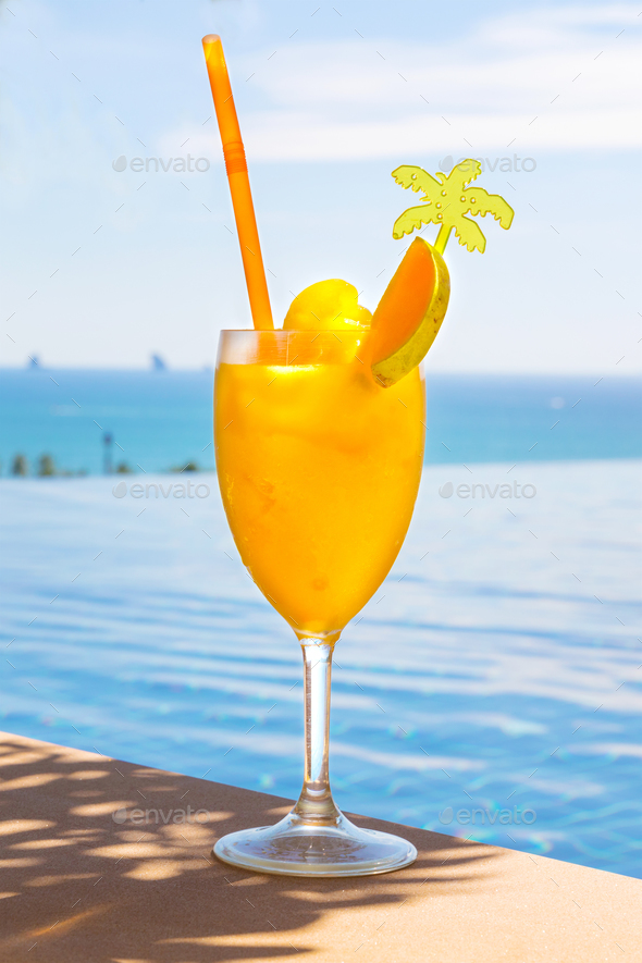 Fresh Mango Juice In Glass At Poolside - Stock Photo - Images