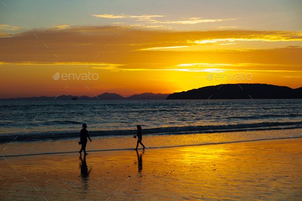 Children Walking At Beach During Sunset - Stock Photo - Images