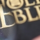 Looking for Holy Bible with Magnifying Glass - VideoHive Item for Sale