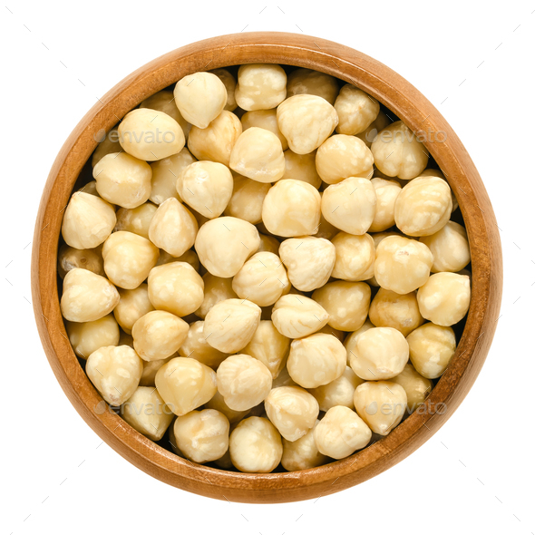 Blanched hazelnuts in wooden bowl - Stock Photo - Images
