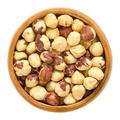 Roasted hazelnuts in wooden bowl