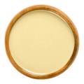 White almond butter in wooden bowl over white