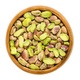 Shelled pistachio kernels in wooden bowl over white - PhotoDune Item for Sale