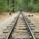 Man Walks Between Railway Rails - VideoHive Item for Sale
