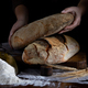 Bread Loaf In Baker Hands - PhotoDune Item for Sale