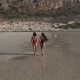 Two Pretty Girls Walking Along the Beach - VideoHive Item for Sale