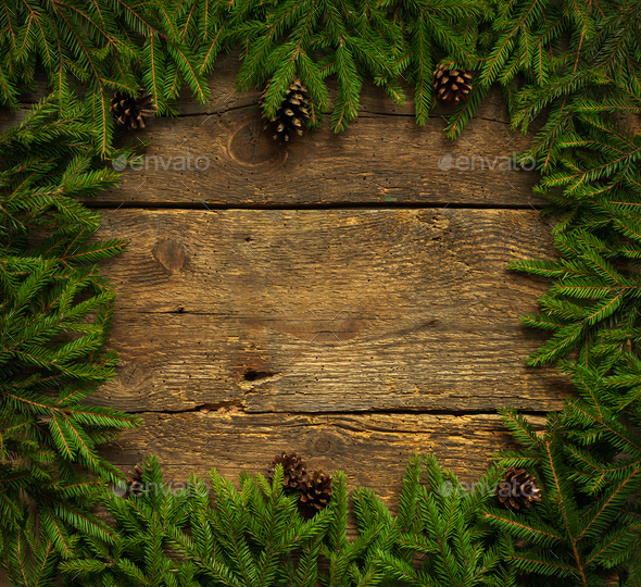 Christmas tree branches with cones on wooden texture ready for y - Stock Photo - Images