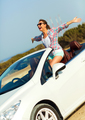 Freedom - happy free woman in cabriolet cheering joyful with arm